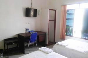 Avicenna Hotel Palangkaraya - Kamar standard dengan 2 kasur kecil