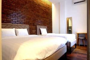 Woodpecker Hotel Yogyakarta - Kamar tamu