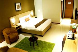 de Laxston Hotel  Yogyakarta - SUITE TEMPAT TIDUR KING
