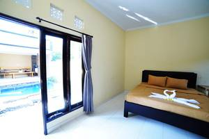 Ratu Guest House By YOM Bali - Deluxe Room
