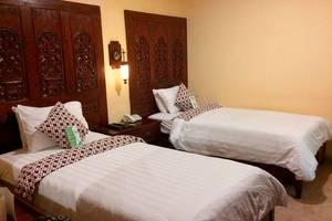 Rumput Hotel Yogyakarta - kamar illalang twin