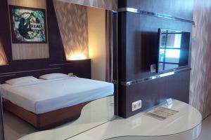 Kartika Abadi Hotel Madiun - Standard King Bedroom