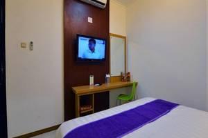 Sofyan Inn Grand Kalimas - Hotel Halal Nyamplungan - Kamar Deluxe
