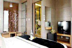 Amos Cozy Hotel Jakarta - Deluxe Room