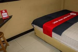 NIDA Rooms Yani 97 Merdeka Walk - Kamar tamu