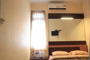 Khresna Guesthouse Yogyakarta - Kamar tamu