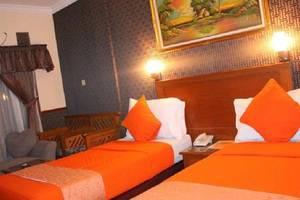 Iscalton Courteous Hotel Sukabumi - tempat tidur Twin