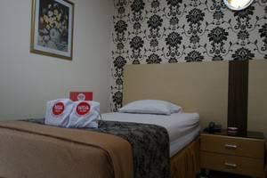 NIDA Rooms Gajah Mada 7 Klojen - Kamar tamu