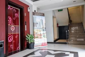 NIDA Rooms Mangga Besar 180 Jakarta - Mengangkat