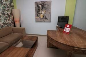 NIDA Rooms Pantai Berawa Discovery Mall Kuta - Ruang tamu