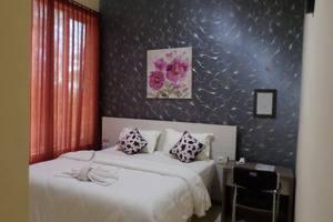 Ambulu Hotel Jember - Kamar Tamu