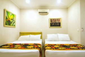 Hawaii Resort Family Suites Anyer - Kamar tamu