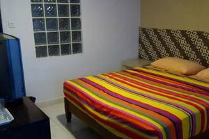 Holiday Beach Inn Pangandaran - Kamar tamu