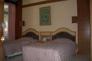 Puri Naga Beach Front Cottage Bali - Rooms