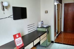 NIDA Rooms Wuruk 38 Jember Desa - Kamar tamu