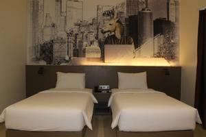 Opi Indah Hotel Palembang - Kamar tamu