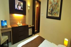 D'Madinah Residence Syariah Hotel Solo Solo - Kamar tamu