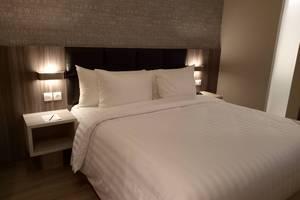 Luminor Hotel Jambi Kebun Jeruk Jambi - Deluxe Room dengan King Bed