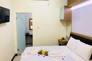 Dragon Palace Hotel Ternate By Amazing Ternate - Kamar Tidur