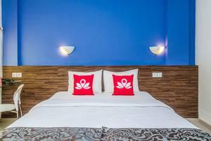 ZenRooms Jimbaran Taman Mulia - Tampak tempat tidur double