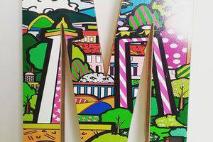 MaxOneHotels at Pemuda Jakarta - majalah pemegang di kamar