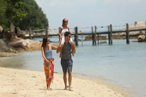 Turi Beach Resort Batam - Family walking on the Beach