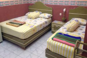 Hotel & Restaurant Anugerah Bondowoso - Tempat tidur di Kamar VIP