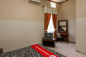 NIDA Rooms Sudirman 419B Pekanbaru - Kamar tamu