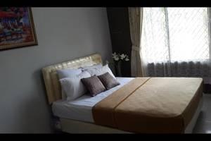 Griya Dharmala Guest House Bandar Lampung - Kamar tamu