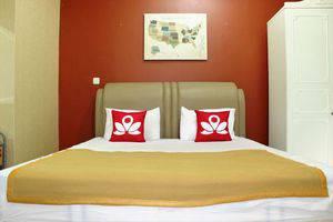 ZenRooms Cipete Utara Jakarta - Tampak tempat tidur double