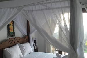 The Shooting Star Homestay Bali - Kamar dengan tempat tidur queen