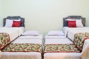 Megaria Hotel Merauke Merauke - 4 Beds dalam 1 Kamar