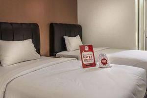 NIDA Rooms Surya Samantri Coblong - Tempat tidur
