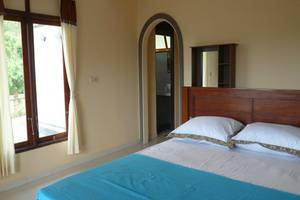 C'est Bon Homestay 2 Bali - Kamar tidur pemandangan laut
