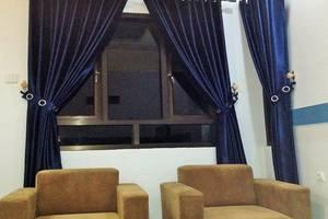 Wisma Ahlen Pangandaran Pangandaran - sofa kamar bungalow