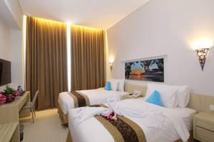 Move Megaland Hotel Solo - Deluxe Tempat Tidur Twin