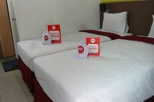 NIDA Rooms Purus 12A Padang Barat - Kamar tamu