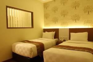 Deivan Hotel Padang - Kamar tamu
