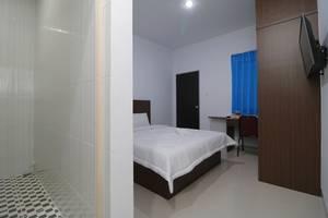 Taman Eden Batam Center Guesthouse Batam - Kamar Tamu