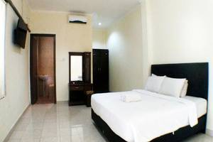 Villa Happy Jimbaran Bali - Deluxe Room - kamar tidur