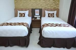 D'Hotel Holiday Makassar Makassar - Room