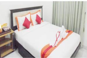 Simply Homy Guest House Timoho Yogyakarta - Room
