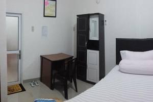 Radial Mas Resto & Kost Palembang - Kamar tamu