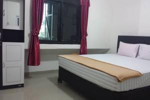 Radial Mas Resto & Kost Palembang - Kamar Tidur King Size