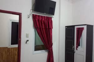 Radial Mas Resto & Kost Palembang - tempat tidur Queen
