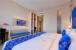 Ohana Hotel Kuta - kamar tidur