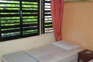 Ateng Guest House Pontianak - room