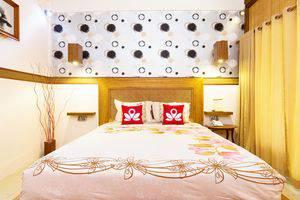 ZenRooms Lombok Raya Senggigi - Tampak tempat tidur double