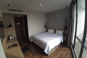 Rivoli Hotel Jakarta - kamar deluxe satu tempat tidur