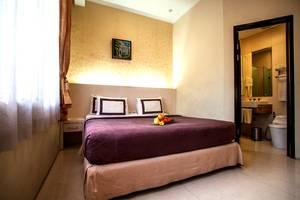 Ros In Hotel Yogyakarta - Kamar Superior King
